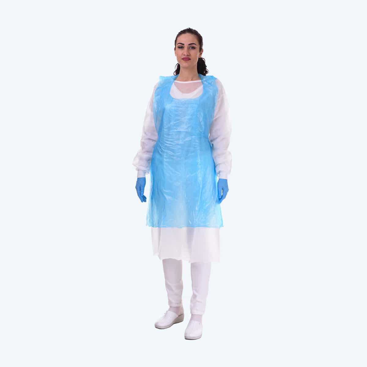 Apron. Lady standing and wearing a plastic apron made to prevent external influence on the doctor. The apron is transparent and covers the front of the body